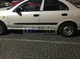 Photo Used Nissan Sunny 2002 Car for Sale in Sharjah