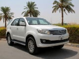 Photo Rent a 2015 Toyota Fortuner in Dubai - AED 180...