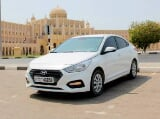 Photo Rent a 2019 Hyundai Accent in Dubai - AED 80...