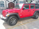 Photo Rent a 2018 Jeep Wrangler Unlimited Sahara...