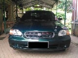 Foto Suzuki baleno th 2000 manual 1500cc irit bertenaga
