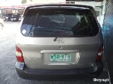 Photo 2001 Kia Carnival Auto Brown AUV