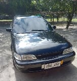 Photo Selling Black Toyota Corolla 1997 in...