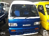 Photo Suzuki Multicab Scrum Mini van 4x4 MT