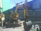Photo Mini back hoe, heavy equipments and other...