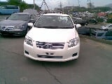 Photo I am selling my Toyota axio X 2007 white color...